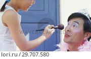 Купить «Cute daughter in fairy costume putting makeup on her fathers face 4k», видеоролик № 29707580, снято 20 марта 2017 г. (c) Wavebreak Media / Фотобанк Лори