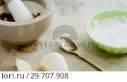 Купить «Black pepper in mortar and pestle with bowl of salt and garlic 4k», видеоролик № 29707908, снято 5 июня 2017 г. (c) Wavebreak Media / Фотобанк Лори