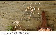 Купить «Himalayan salt with rosemary in wooden bowl 4k», видеоролик № 29707920, снято 5 июня 2017 г. (c) Wavebreak Media / Фотобанк Лори