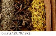 Купить «Various spices arranged in row 4k», видеоролик № 29707972, снято 5 июня 2017 г. (c) Wavebreak Media / Фотобанк Лори