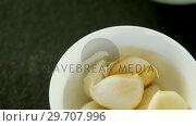 Купить «Ginger, garlic and slice lemon in bowl 4k», видеоролик № 29707996, снято 5 июня 2017 г. (c) Wavebreak Media / Фотобанк Лори