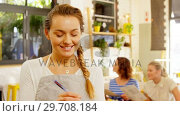 Купить «Beautiful waitress writing order in notepad 4k», видеоролик № 29708184, снято 21 мая 2017 г. (c) Wavebreak Media / Фотобанк Лори