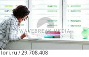 Купить «Woman reading a novel 4k», видеоролик № 29708408, снято 2 ноября 2016 г. (c) Wavebreak Media / Фотобанк Лори