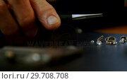 Close-up of goldsmith examining diamond 4k. Стоковое видео, агентство Wavebreak Media / Фотобанк Лори