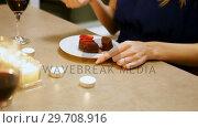 Купить «Woman having dessert at home 4k», видеоролик № 29708916, снято 25 марта 2017 г. (c) Wavebreak Media / Фотобанк Лори