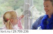 Купить «Father and daughter playing with fairy wand 4k», видеоролик № 29709236, снято 23 января 2020 г. (c) Wavebreak Media / Фотобанк Лори