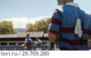 Купить «Rugby player running while holding oval ball 4k», видеоролик № 29709280, снято 9 февраля 2017 г. (c) Wavebreak Media / Фотобанк Лори