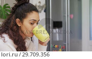 Купить «Thoughtful woman looking away while having coffee in the kitchen 4K 4k», видеоролик № 29709356, снято 31 мая 2017 г. (c) Wavebreak Media / Фотобанк Лори