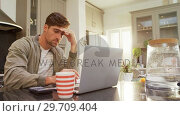 Купить «Worried man using his calculator while working on laptop 4K 4k», видеоролик № 29709404, снято 31 мая 2017 г. (c) Wavebreak Media / Фотобанк Лори