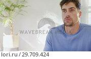 Купить «Serious young man watching television at home 4K 4k», видеоролик № 29709424, снято 31 мая 2017 г. (c) Wavebreak Media / Фотобанк Лори