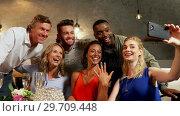Купить «Woman showing ring to her friends while taking selfie 4K 4k», видеоролик № 29709448, снято 28 мая 2017 г. (c) Wavebreak Media / Фотобанк Лори