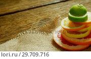 Купить «Various citrus slices stack on jute fabric 4K 4k», видеоролик № 29709716, снято 12 июня 2017 г. (c) Wavebreak Media / Фотобанк Лори