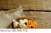 Купить «Dried orange with ginger in a plate 4k», видеоролик № 29709772, снято 12 июня 2017 г. (c) Wavebreak Media / Фотобанк Лори