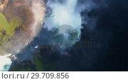 Купить «Beautiful water fall through forest cliff on a sunny day 4k», видеоролик № 29709856, снято 3 августа 2017 г. (c) Wavebreak Media / Фотобанк Лори
