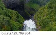 Купить «Beautiful water fall through forest cliff on a sunny day 4k», видеоролик № 29709864, снято 3 августа 2017 г. (c) Wavebreak Media / Фотобанк Лори