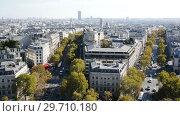 Купить «Cityscape of Paris with the Eiffel Tower and apartment buildings aerial view, France», видеоролик № 29710180, снято 27 октября 2018 г. (c) Яков Филимонов / Фотобанк Лори