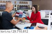 Купить «Consultant helping woman choosing upholstery fabric», фото № 29710812, снято 29 октября 2018 г. (c) Яков Филимонов / Фотобанк Лори