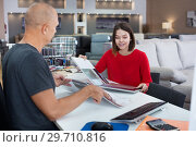 Купить «Consultant helping woman choosing upholstery fabric», фото № 29710816, снято 29 октября 2018 г. (c) Яков Филимонов / Фотобанк Лори