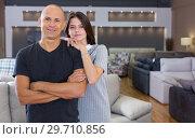 Купить «Couple posing in furniture salon», фото № 29710856, снято 29 октября 2018 г. (c) Яков Филимонов / Фотобанк Лори