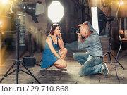 Купить «Professional photo shooting outdoors. Attractive female model po», фото № 29710868, снято 5 октября 2018 г. (c) Яков Филимонов / Фотобанк Лори