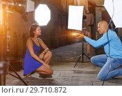 Купить «woman posing for professional photographer», фото № 29710872, снято 5 октября 2018 г. (c) Яков Филимонов / Фотобанк Лори