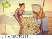 Купить «Professional photo shooting outdoors. positive female model posi», фото № 29710884, снято 5 октября 2018 г. (c) Яков Филимонов / Фотобанк Лори