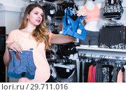 Купить «Female person is choosing sports underwear», фото № 29711016, снято 20 марта 2017 г. (c) Яков Филимонов / Фотобанк Лори