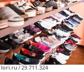 Купить «Stylish footwear are standing in boutique», фото № 29711324, снято 10 мая 2017 г. (c) Яков Филимонов / Фотобанк Лори