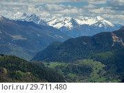 Купить «Snow mountains and village in Switzerland», фото № 29711480, снято 15 мая 2017 г. (c) Михаил Коханчиков / Фотобанк Лори