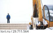 Купить «Construction site. The hook of industrial crane hooked the detail», видеоролик № 29711564, снято 19 сентября 2019 г. (c) Константин Шишкин / Фотобанк Лори