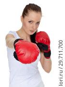 Купить «Young woman in fighting gloves», фото № 29711700, снято 22 марта 2011 г. (c) Мельников Дмитрий / Фотобанк Лори