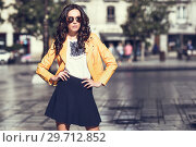 Купить «Young brunette woman with sunglasses in urban background», фото № 29712852, снято 11 марта 2017 г. (c) Ingram Publishing / Фотобанк Лори