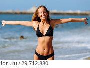 Купить «Young blonde woman with beautiful body in swimwear on a tropical beach with open arms.», фото № 29712880, снято 24 сентября 2017 г. (c) Ingram Publishing / Фотобанк Лори