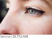 Купить «Close-up shot of blue eye of young woman», фото № 29712928, снято 23 апреля 2017 г. (c) Ingram Publishing / Фотобанк Лори