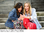 Купить «Two young women looking some awesome thing on their smart phone», фото № 29712956, снято 7 марта 2018 г. (c) Ingram Publishing / Фотобанк Лори