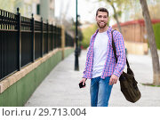 Купить «Young bearded man smiling in urban background. Lifestyle concept.», фото № 29713004, снято 5 апреля 2018 г. (c) Ingram Publishing / Фотобанк Лори