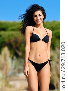 Купить «Young arabic woman with beautiful body in swimwear smiling on a tropical beach.», фото № 29713020, снято 24 сентября 2017 г. (c) Ingram Publishing / Фотобанк Лори