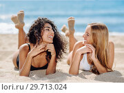 Two young women with beautiful bodies in swimsuit on a tropical beach. Стоковое фото, фотограф Javier Sánchez Mingorance / Ingram Publishing / Фотобанк Лори