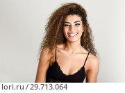 Купить «Young happy woman with curly hairstyle smiling», фото № 29713064, снято 21 января 2018 г. (c) Ingram Publishing / Фотобанк Лори