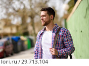 Купить «Attractive young man standing in urban background. Lifestyle concept.», фото № 29713104, снято 5 апреля 2018 г. (c) Ingram Publishing / Фотобанк Лори