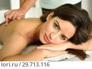 Купить «Young female receiving a relaxing back massage in a spa center. », фото № 29713116, снято 23 ноября 2017 г. (c) Ingram Publishing / Фотобанк Лори
