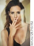Купить «Young beautiful brunette woman in lingerie smoking cigarette», фото № 29713152, снято 28 ноября 2017 г. (c) Ingram Publishing / Фотобанк Лори