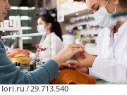 Купить «Manicurists giving manicure», фото № 29713540, снято 28 апреля 2017 г. (c) Яков Филимонов / Фотобанк Лори