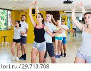 Купить «People dancing salsa in studio», фото № 29713708, снято 21 июня 2017 г. (c) Яков Филимонов / Фотобанк Лори