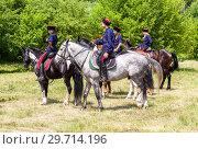 Купить «Young cossacks in traditional uniform on the horses», фото № 29714196, снято 18 июня 2016 г. (c) FotograFF / Фотобанк Лори