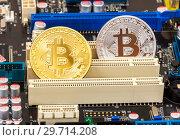 Купить «Coins of Cryptocurrency Bitcoin lying over electronic computer component», фото № 29714208, снято 10 марта 2018 г. (c) FotograFF / Фотобанк Лори