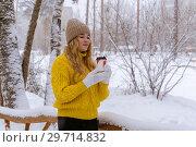 Купить «Girl with coffee in winter outdoors», фото № 29714832, снято 13 января 2019 г. (c) Евгений Харитонов / Фотобанк Лори