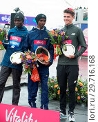 Купить «Vitality Big Half Marathon in London. The Finish Line and Presentations at the Cutty Sark in Greenwich, London Featuring: Daniel Wanjiru, Sir Mo Farah...», фото № 29716168, снято 4 марта 2018 г. (c) age Fotostock / Фотобанк Лори