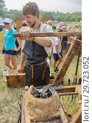 Купить «Russia, Samara, July, 2018: Blacksmithing workshop. Ethno-historical festival with the reconstruction of the battle of 1391 (Timur and Tokhtamysh)», фото № 29723052, снято 29 июля 2018 г. (c) Акиньшин Владимир / Фотобанк Лори