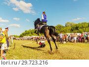 Купить «Russia, Samara, July, 2018: a Cossack girl rides a horse and performs tricks.», фото № 29723216, снято 29 июля 2018 г. (c) Акиньшин Владимир / Фотобанк Лори